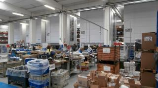 Storage systems and vertical lift machines